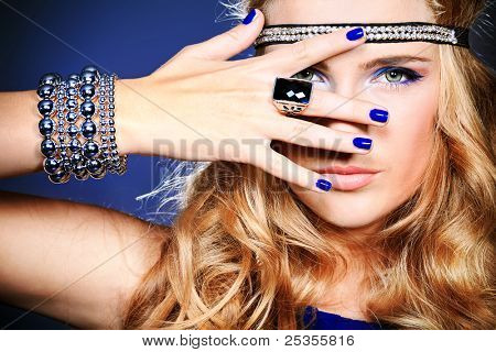 Portrait of a beautiful woman. Jewelry, make-up.
