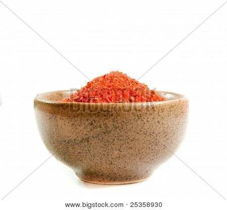 red spices in a ceramic bowl