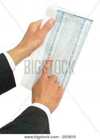Hands Holding Newspaper With Stock Reports