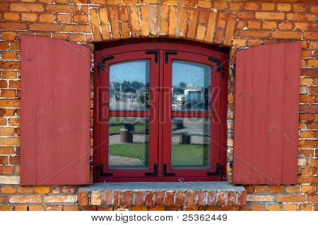 Vintage Wooden Window On Red Brick Wall