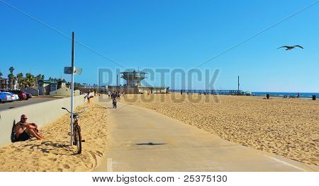 VENICE, US - OCTOBER 17: View of Venice Beach with its Pier in the background on October 17, 2011 in Venice, US. Dozen of movies are filmed in the Venice Pier, a 1,310-foot (400 m) concrete structure