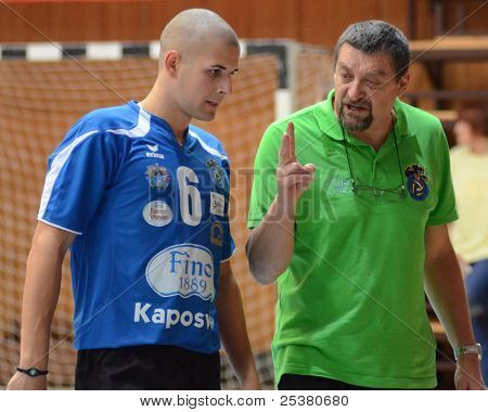 KAPOSVAR, HUNGARY - NOVEMBER 13: Gyorgy Demeter (Kaposvar trainer) (R) in action at a Hungarian Championship volleyball game Kaposvar (b) vs. Nyiregyhaza (r), November 13, 2011 in Kaposvar, Hungary.