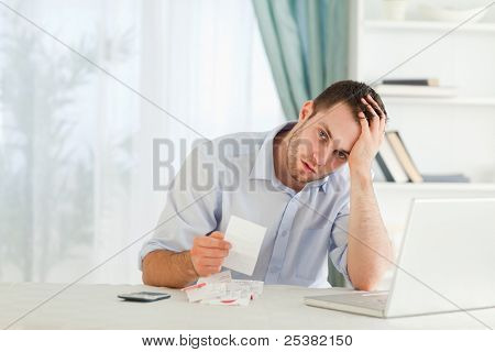 Young businessman worried about an invoice