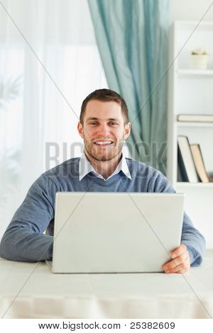 Smiling young male in his homeoffice