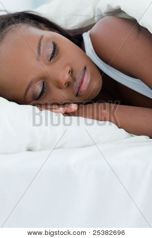 Portrait of a beautiful woman sleeping in her bedroom