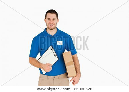 Smiling young salesman with parcel and clipboard against a white background