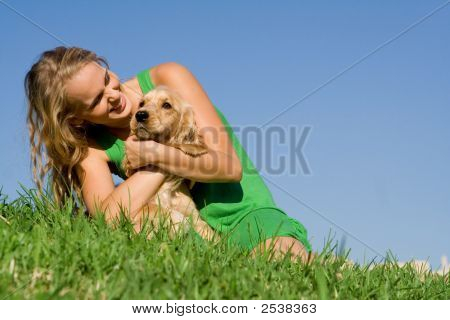 Loving Girl With Pet Dog