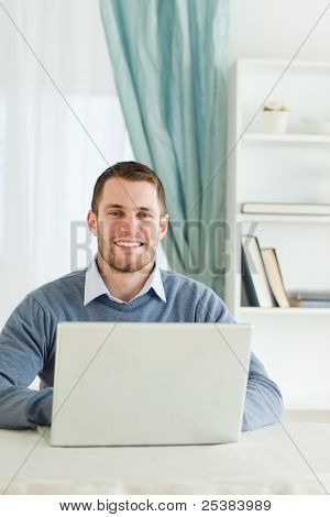 Smiling young businessman in his homeoffice