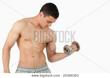 Young male lifting weight against a white background