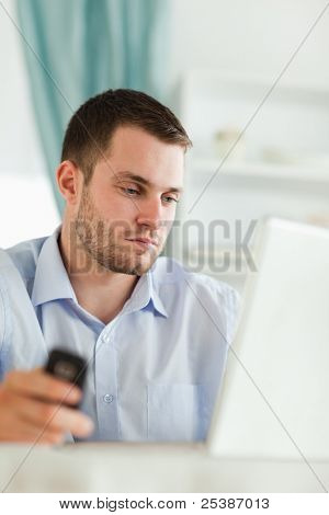 Young businessman with notebook and cellphone