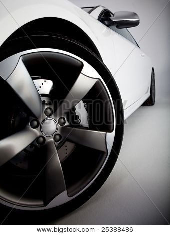 Picture of a white sports car focusing on the tire