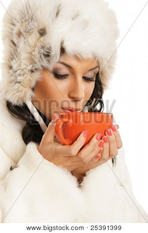 Young and beautiful woman with a red cup isolated on white
