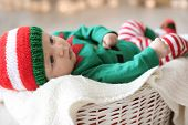 Cute Baby Wearing Christmas Costume Lying In Basket At Home poster