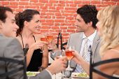 stock photo of foursome  - romantic foursome at restaurant - JPG