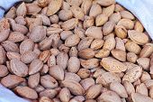 Shelled Almonds As Background. Close Up View Of Shelled Almonds Texture And Background For Designers poster