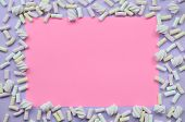 Colorful Marshmallow Laid Out On Violet And Pink Paper Background. Pastel Creative Textured Framewor poster