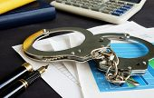 Financial Fraud Concept. Business Documents And Handcuffs. poster