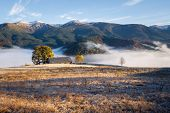 Autumn landscape with morning mist in the mountains poster