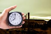 Holding Clock On Industry Blurred Background The Time 8:00 Am Or Pm And Noon Or Midnight For Made Cl poster