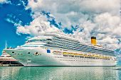 Big Cruise Ship. Large Luxury Cruise Ship On Sea Water And Cloudy Sky Background Docked At Port Of S poster