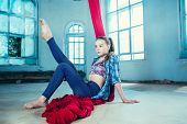 Graceful Gymnast Resting After Performing Aerial Exercise With Red Fabrics On Blue Old Loft Backgrou poster