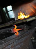 stock photo of blacksmith shop  - Blacksmith forges a red - JPG