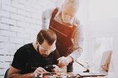 Two Men Repairing Hardware Equipment In Workshop. Repair Shop. Worker With Tools. Computer Hardware. poster