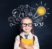 Child Ideas. Smiling Child School Student With Yellow Book, Lightbulb And Chalk Question Marks. Brai poster
