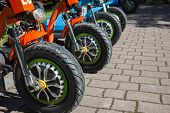 Three Wheel Electric Bicycle Row In Rental Point poster