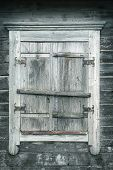 Gray Wooden Vertical Background. The Wall Of The Old House With A Window. Window Frames, Shutters An poster