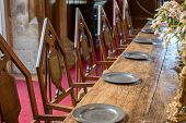 Medieval Dining Table And Chairs. Mediaeval Period Banquet Table Set With Metal Plates. Fine Histori poster