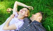 Couple In Love Relaxing Lay At Meadow. Nature Fills Them With Freshness And Peace. Man Unshaven And  poster