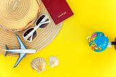 Flat Lay With Hat, Plane, Passport, Globe, Sunglasses And Shell On Yellow Colourful Trendy Modern Fa poster