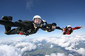 pic of sky diving  - Three Skydivers form a line for a photo - JPG