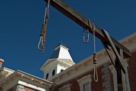 picture of gunfights  - Looking through hanging noose at the county Courthouse National historical landmark in Tombstone America - JPG