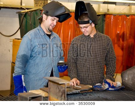 Welders Discussing The Job