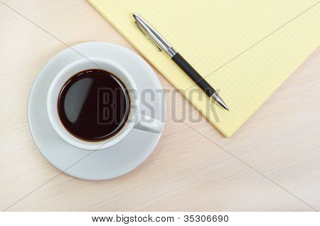 Coffee cup with note book