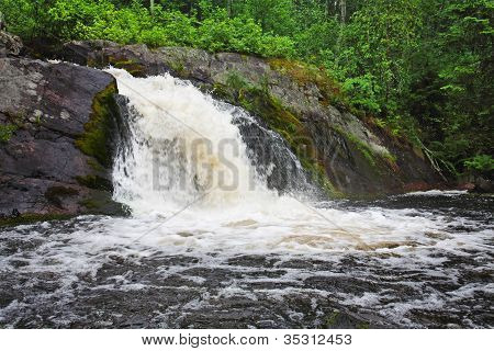 Beautiful landscape with wood and a falls.