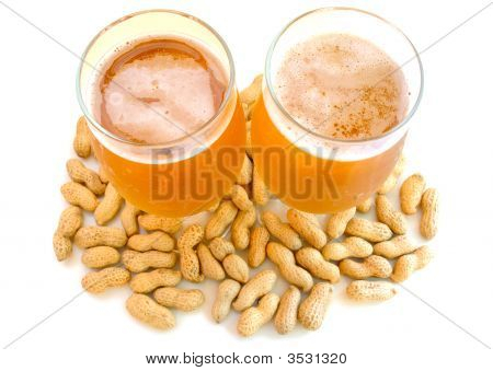 Beer In Glass  And Peanuts  In Shells.