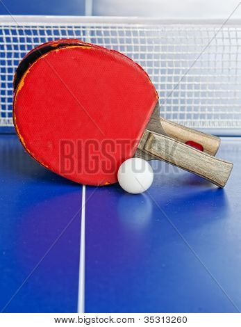 wo table tennis or ping pong rackets and balls