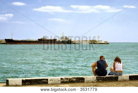 Summer Day Man And Woman Sitting At Berth