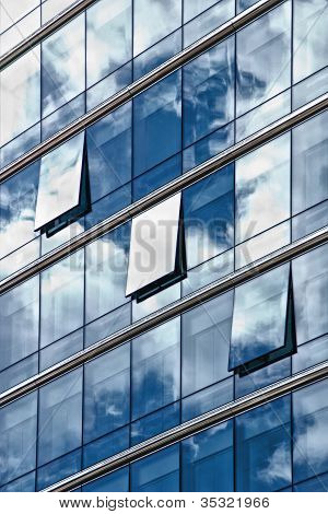 sky reflected in windows of a building