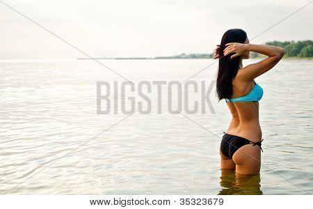 Pretty Woman Posing In The Sea