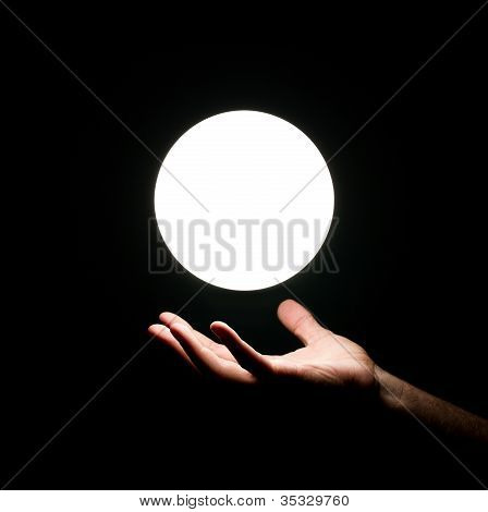 Light Ball Ove Human Hand