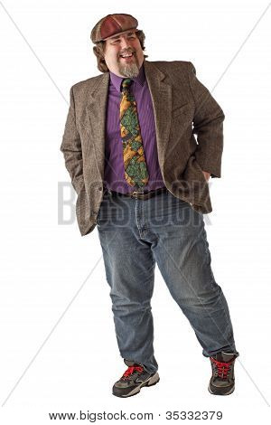 Large Man Laughs And Stands With Hands In Pockets