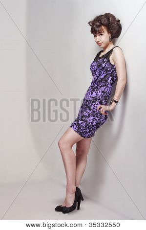 Beautiful Girl In A Violet Dress