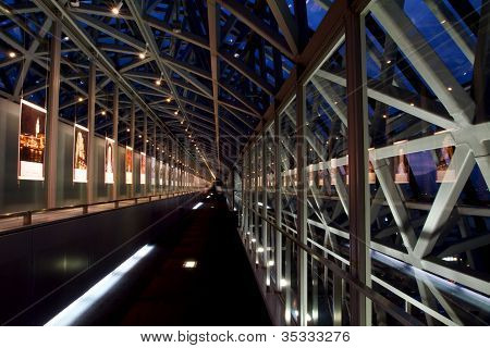 Interior View of Urban Skywalk at Night