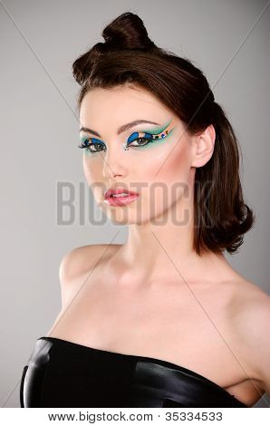 Young Beautiful Woman With Makeup In Black Dress