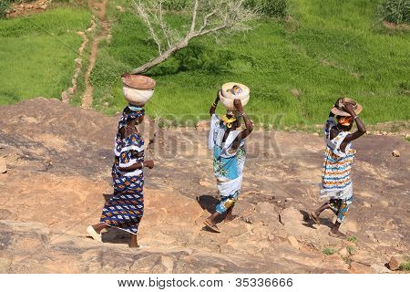 Three women on their way to work in West Africa
