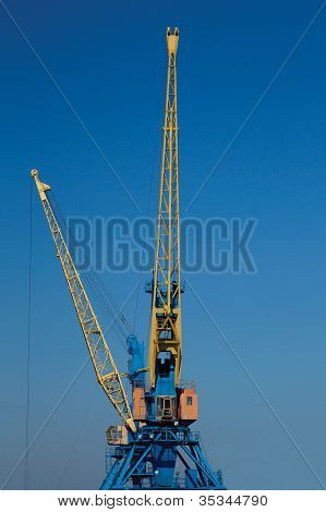 A Crane Boom With Main Block And Jib Against A Clear Blue Sky